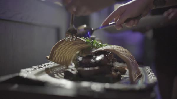 Hand-held shot of a chef breaking a lattice pastry dome over roasted meat Royalty-free stock video