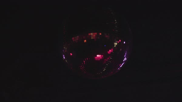 Hand-held shot of spinning disco balls Royalty-free stock video