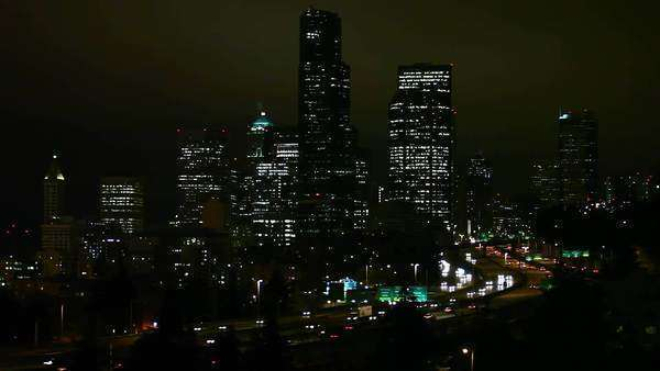 Seattle, Washington - November 2011: Static view of Seattle at night as traffic drives by Royalty-free stock video
