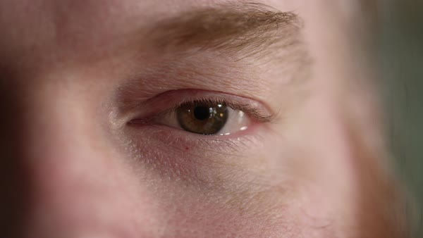 Tight shot of mans left eye with a blank stare into the camera. Royalty-free stock video
