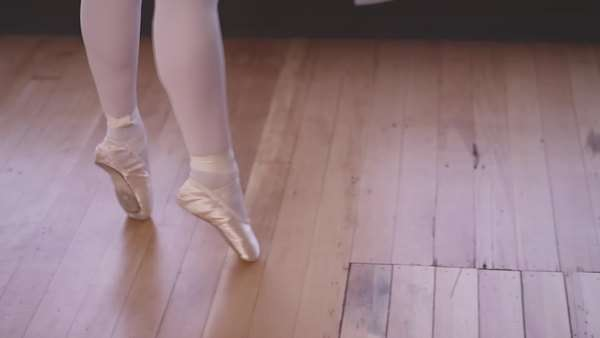 Close-up of pointe shoes as a ballet dancer spins across the studio Royalty-free stock video