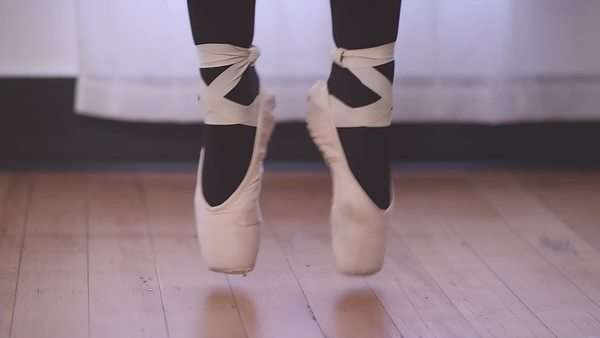 Close-up of a ballet dancer's feet as she jumps and changes positions Royalty-free stock video