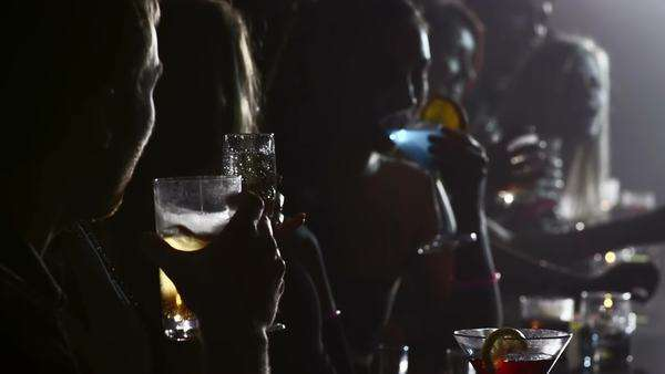 Dark shot of a row of people drinking at a bar Royalty-free stock video