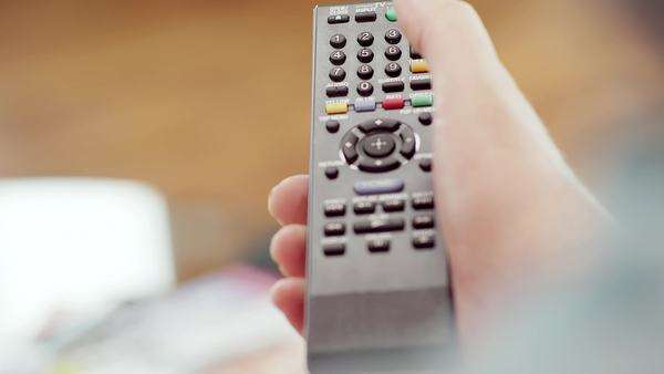 Close up of a hand operating a remote control Royalty-free stock video