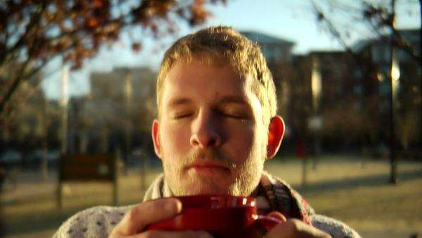 Close up of a young man drinking a hot beverage Royalty-free stock video