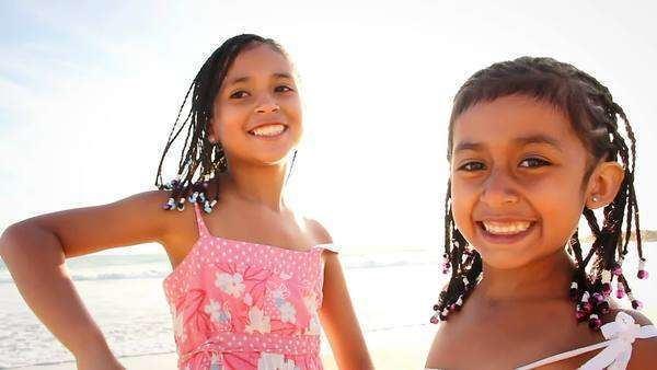 A young girls dance and smiles and poses for the camera on a beach in Mexico Royalty-free stock video