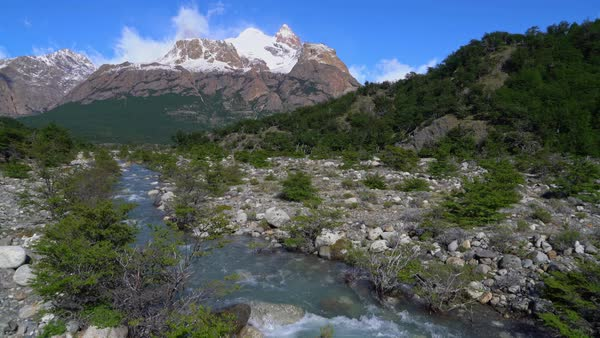 El Chalten rushing stream and mountains Royalty-free stock video