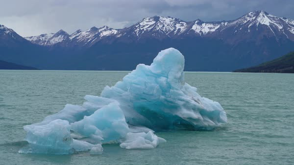 Perito Moreno Glacier floating iceberg and mountains Royalty-free stock video