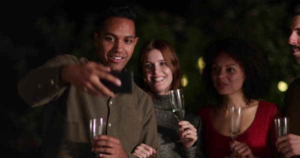 Friends celebrating outdoors taking a selfie Royalty-free stock video