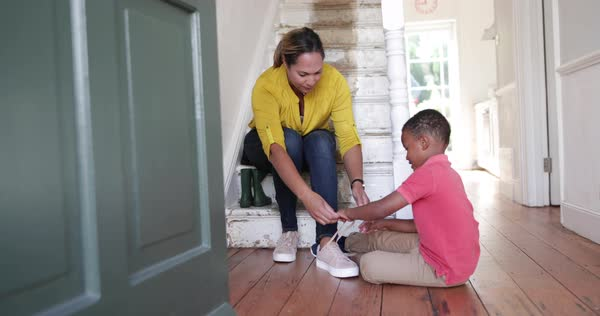 Boy learning to tie shoe laces Royalty-free stock video
