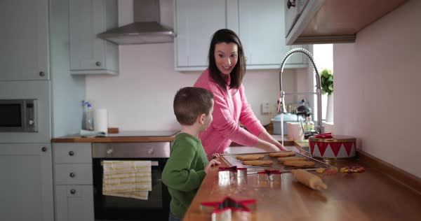 Mother and son baking cookies in kitchen Royalty-free stock video