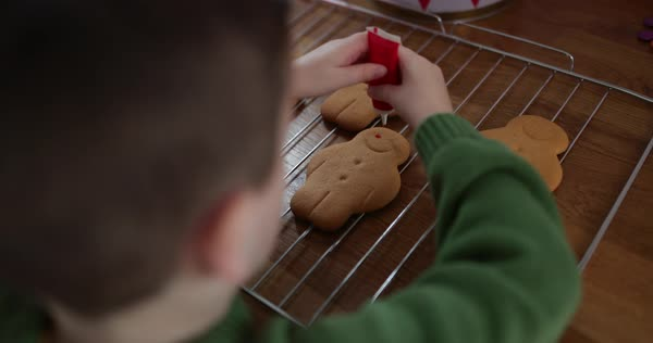 Boy decorating gingerbread men Royalty-free stock video