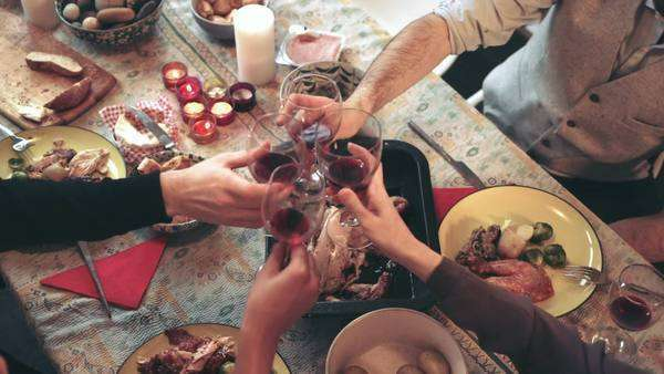 Friends toasting and drinking red wine during Christmas party Royalty-free stock video