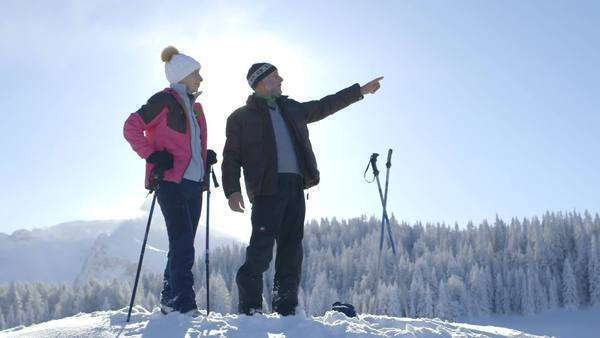 Senior couple standing with ski pole and looking at view Royalty-free stock video