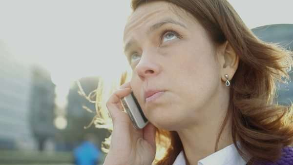 Business woman takes a business call, close-up Royalty-free stock video