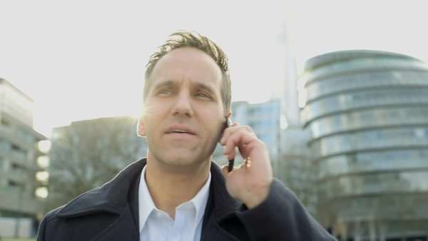 Business Man takes a business call, close-up Royalty-free stock video