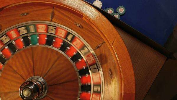 Medium close-up of Birdseye Pan of Roulette Table and Players Royalty-free stock video