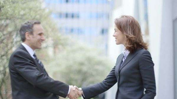 Business Man and Business Woman meeting each other, medium shot Royalty-free stock video