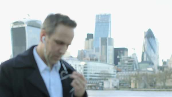 Business man makes a call in the city Royalty-free stock video