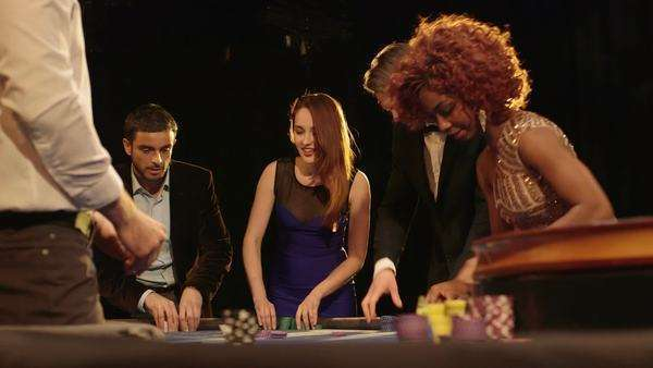 Sliding Medium shot of Players Gambling in the Casino Royalty-free stock video