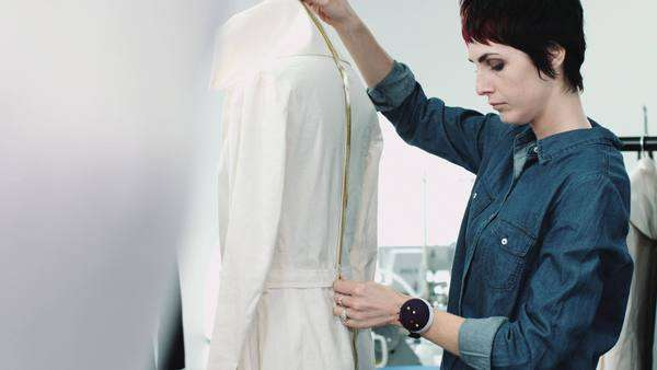 Fashion designer measuring mannequin in studio Royalty-free stock video