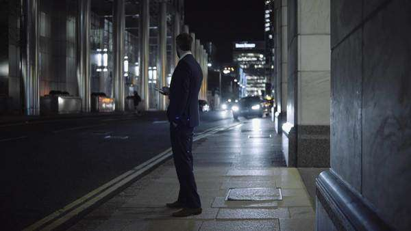 Business man waiting for taxi outside office Royalty-free stock video