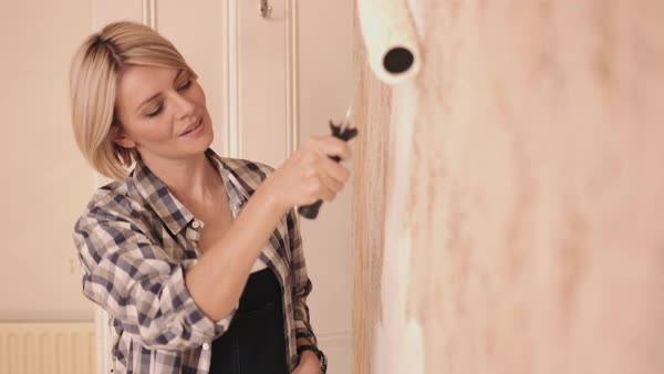 Woman painting wall in new home Royalty-free stock video
