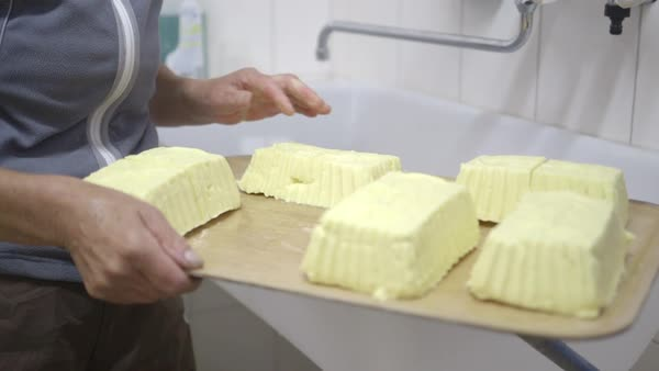 Woman farmer making butter at dairy farm Royalty-free stock video