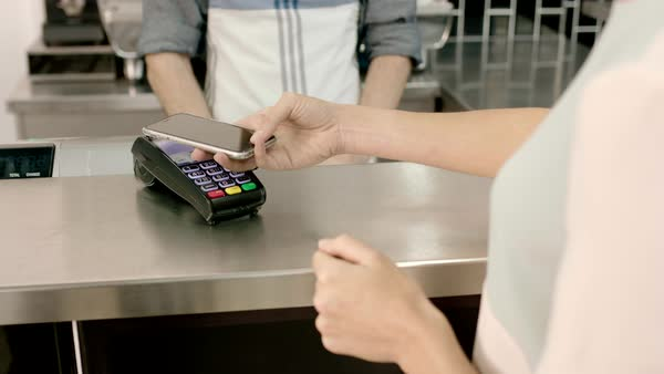 Businesswoman paying contactless in cafe Royalty-free stock video