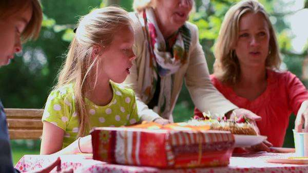 Family enjoying birthday party in garden Royalty-free stock video