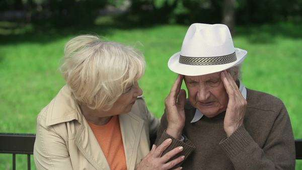 Close up of senior woman reassuring man massaging his head from headache Royalty-free stock video