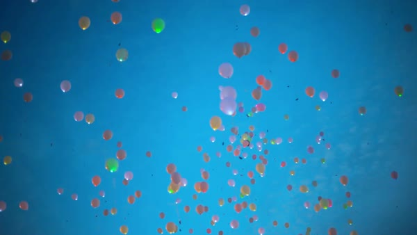 Blinking helium balloons flying up to the sky Royalty-free stock video