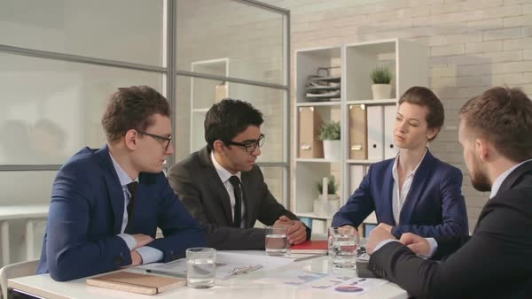 Woman boss signing documents and giving handshake to her male colleagues Royalty-free stock video