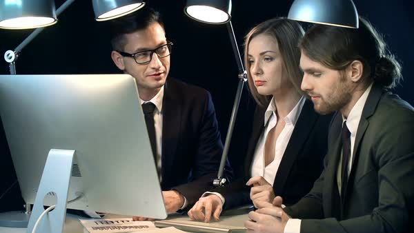 Group of young office workers discussing new business project late in the office Royalty-free stock video