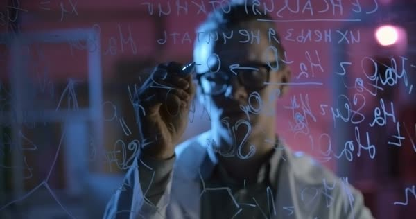 Chemistry student behind glass wall writing molecular formula  Royalty-free stock video