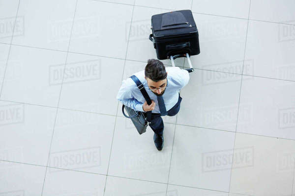 High angle view of businessman leaving for business Royalty-free stock photo