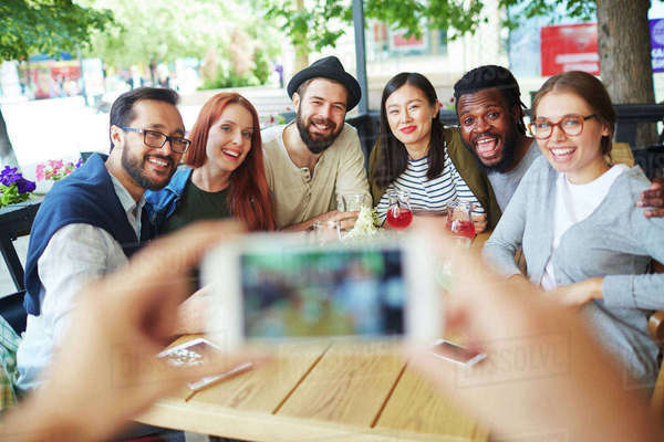 Happy freinds posing for selfie in cafe Royalty-free stock photo