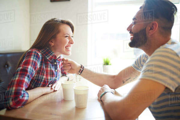 Happy young couple sitting in cafe Royalty-free stock photo