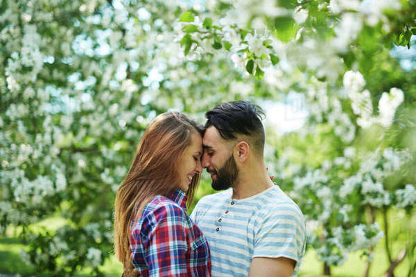 Amorous couple enjoying walk in park Royalty-free stock photo