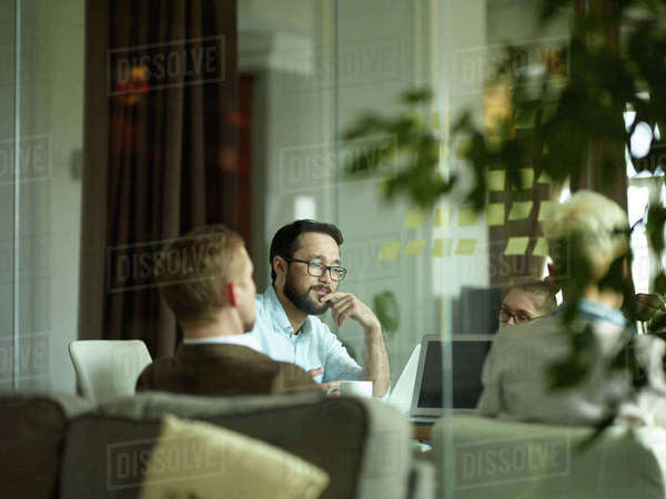 Young manager sitting at meeting with his colleagues Royalty-free stock photo