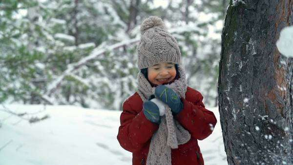 Little boy playing snowballs with someone out of camera reach Royalty-free stock video