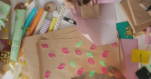 Creative Young Women Painting Colourful Handmade Gift Wrap And