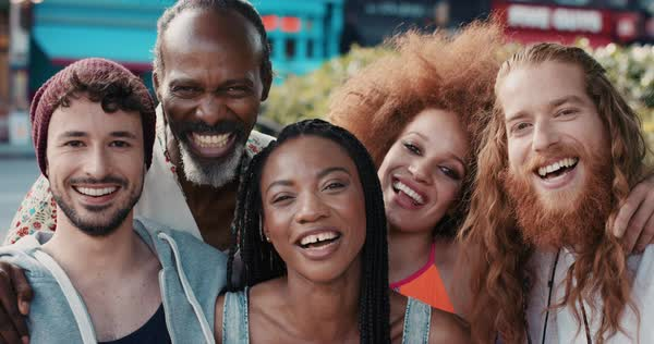 Portrait of happy multi ethnic group of people smiling in the city, slow motion Royalty-free stock video