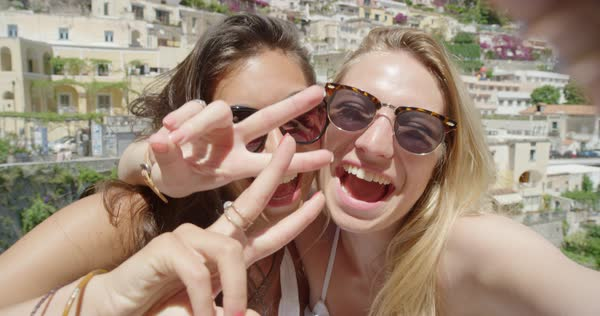 Girlfriends taking selfies on vacation Royalty-free stock video