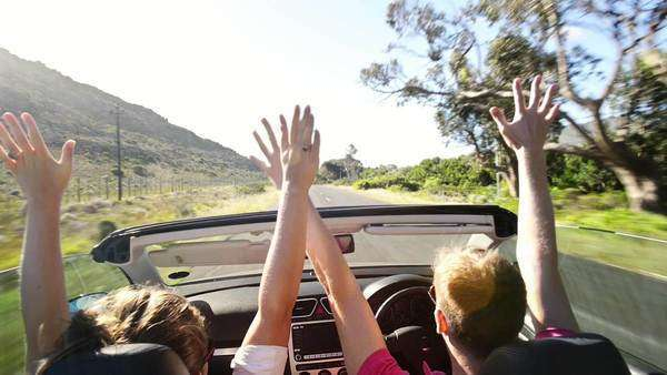 Couple driving convertible car in Cape Town, South Africa Royalty-free stock video