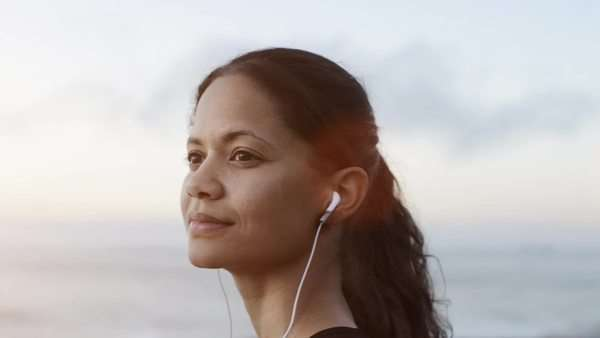 Beautiful woman portrait looking at ocean views and listening to music Royalty-free stock video