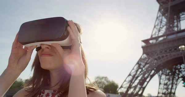 Young woman at Eiffel tower Paris wearing virtual reality headset watching 360 video imagination VR concept Royalty-free stock video