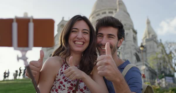 Couple taking selfie photograph Sacre Coeur Paris with smartphone in city enjoying summer holiday European vacation travel adventure Royalty-free stock video