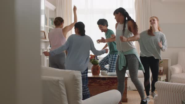 Happy multiracial family dancing at home having fun enjoying dance celebrating exciting weekend together wearing pajamas - Stock Video Footage - Dissolve