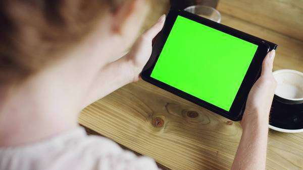 Green screen hands using digital tablet touchscreen device iPad in cafe Royalty-free stock video